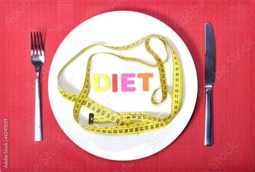 measure tape as meal on dish in diet concept