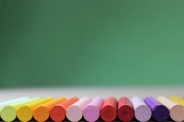 Crayons lined up in rainbow