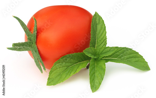 Ripe tomato with mint leaves