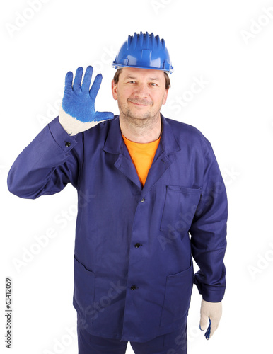 Worker putting on rubber glove