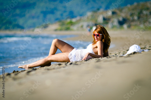 girl in a white bathing suit on the beach