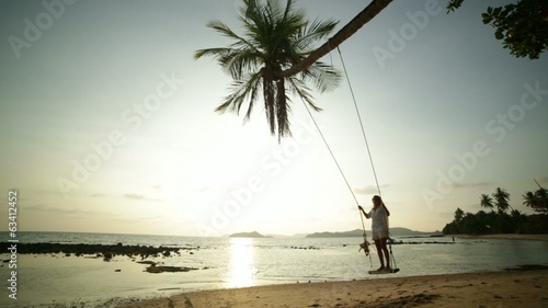Woman on a swing in tropical settings