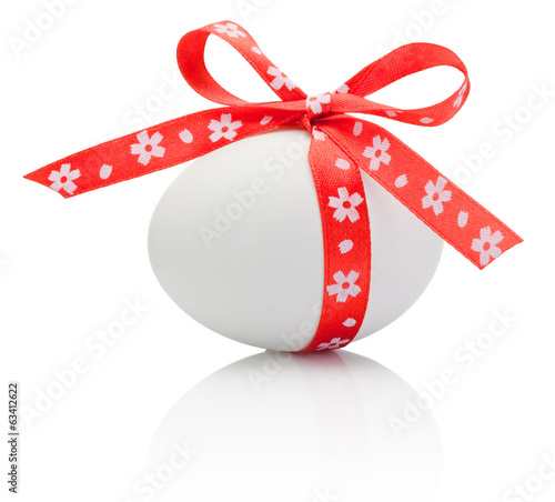 Easter eggs tied red ribbon with flower symbol bow isolated on w