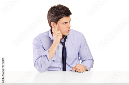 Surprised man sitting at a table