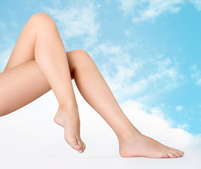 legs nude of woman on sky background