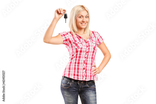 Young woman holding car key