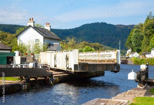 Leinwanddruck Bild Canal lock with swing bridge