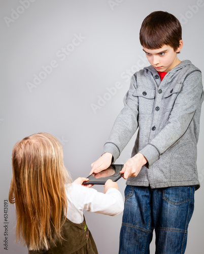 Children fight for tablet computer