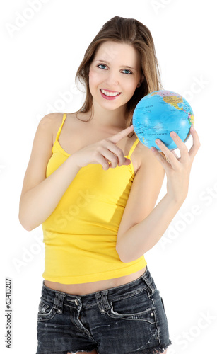 smiling girl pointing to map of the world