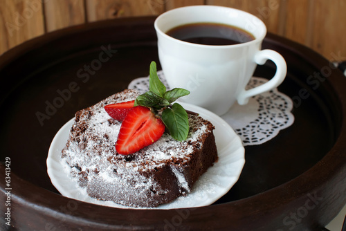 Slice of chocolate cake with strawberries