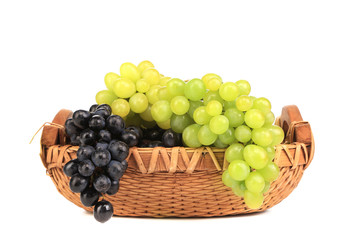 Assortment of ripe grapes in basket.