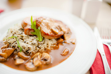 Juicy,  succulent grilled pork chops with mushrooms and rice