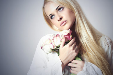 Beautiful Blond Woman with Bouquet of Flowers.girl and roses