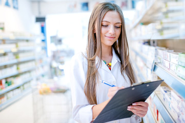 portrait of blonde pharmacist or health care worker