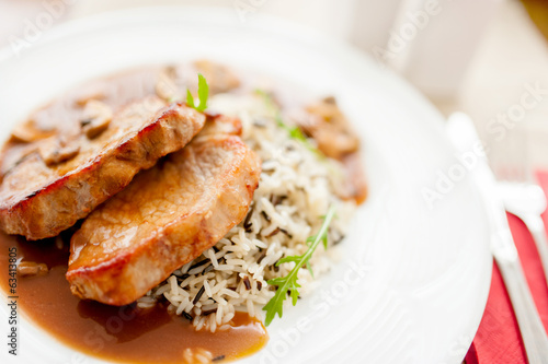 grilled succulent pork chop and rice as main course