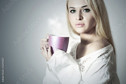 Beautiful blond woman drinking Coffee.Sweet girl in the Morning
