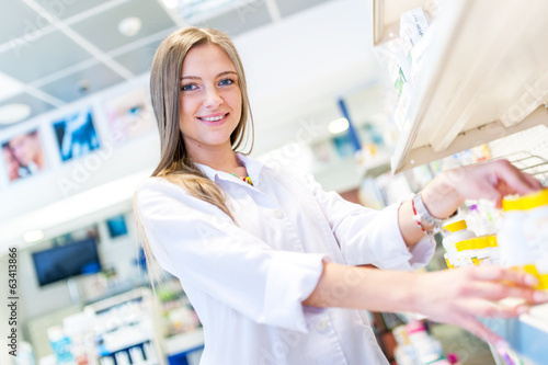 Sexy blonde pharmacist selling antibiotics and prescription drug
