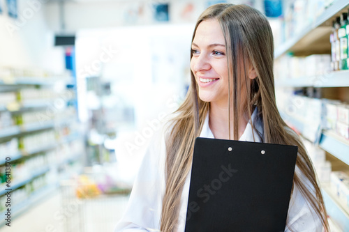 portrait of smiling blonde female pharmacist