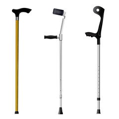 Set of orthopedic walking sticks on white background