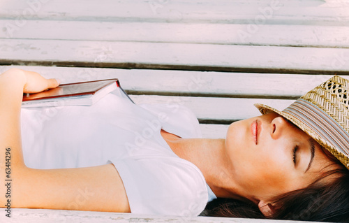 Girl hipster rests on a bench