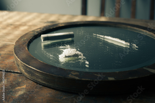 Cocaine and banknote on a mirror