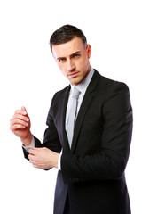Businessman buttoning cuff sleeves