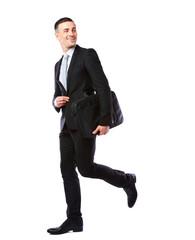 Businessman walking with laptop bag