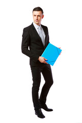 pensive businessman standing with blue folder