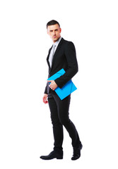 businessman standing with blue folder over white background