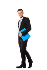 Businessman standing with blue folder in hands