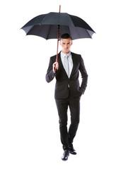 full-length portrait of a businessman holding umbrella