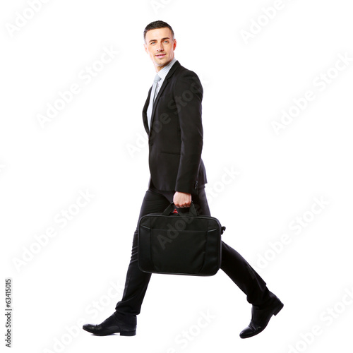 Businessman walking with laptop bag
