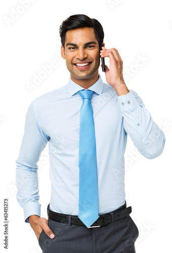 Smiling Businessman Using Smart Phone