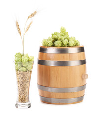 Barrel with hops and wheat.