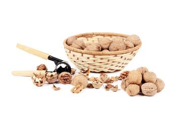 Walnuts in basket and nutcracker.