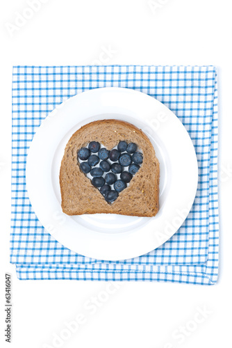 piece of bread with the middle filled with blueberry