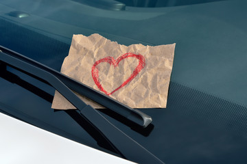 drawn heart under windshield wiper