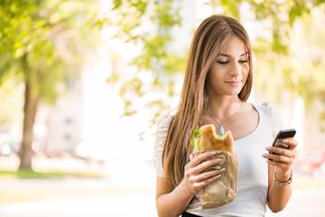 Young Woman taking a break for breakfast