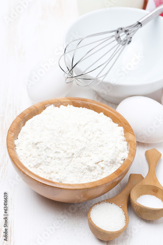 flour, salt, sugar and eggs for baking