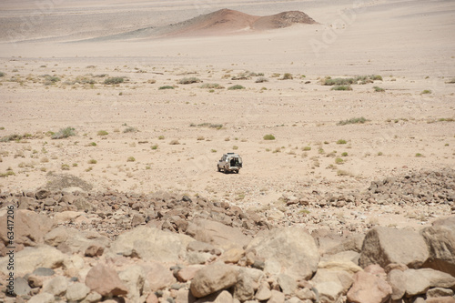 Off-road vehicle parked in an arid desert
