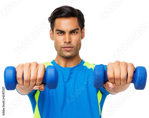 Determined Man Exercising With Dumbbells