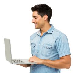 Smiling Young Man Using Laptop