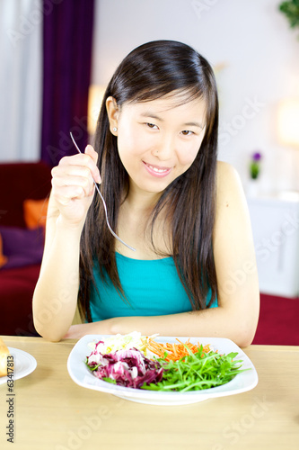 Cute asian woman at home on a healthy diet