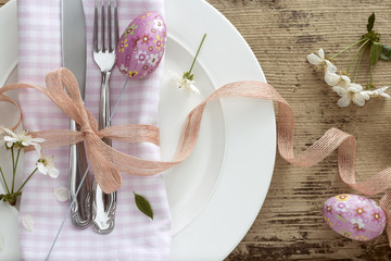 Easter place setting with spring flower on wooden background