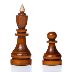 Wooden chessmen isolated on a white background. King and pawn
