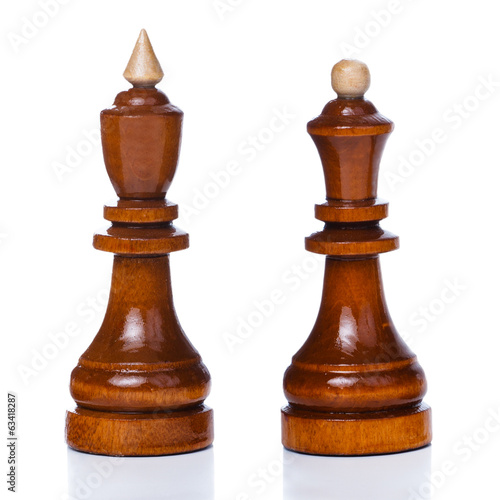 Wooden chessmen isolated on a white background. King and queen