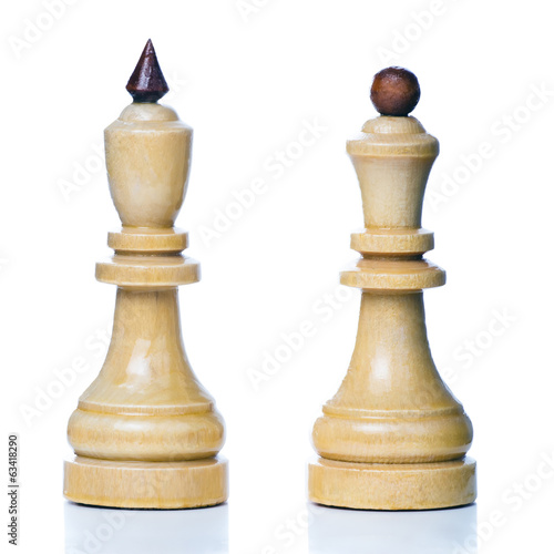 Wooden chess-men isolated on a white background. King and queen