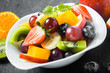 Colorful bowl of healthy tropical fruit salad