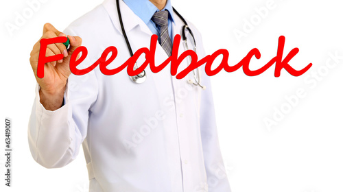 Doctor writing word Feedback on transparent board