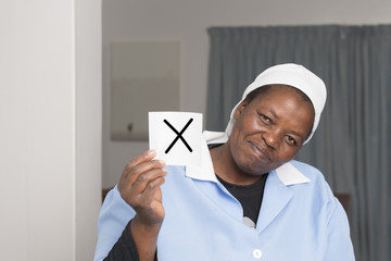 cleaning lady holds her vote